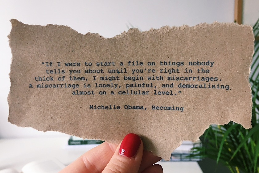 Hand holding a quote on brown paper that reads: If I were to start a file on things nobody tells you about until you're right in the thick of them, I might begin with miscarriages. A miscarriage is lonely, painful, and demoralising almost on a cellular level.""